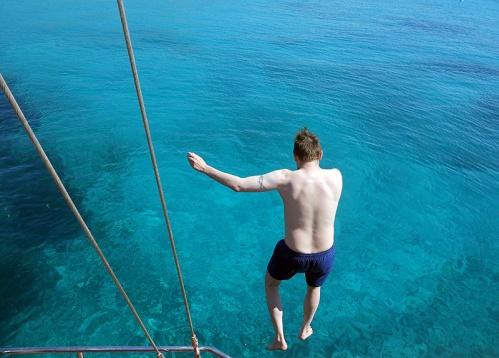 malta-kamino-blue-lagoon-david-j-rodger-jumping-off-bow-of-a-yacht